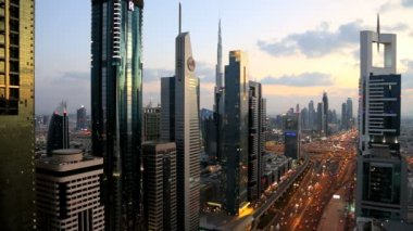 Dubai UAE Sheikh Zayed Road skyscraper Burj Kalifa sunset — Stock Video