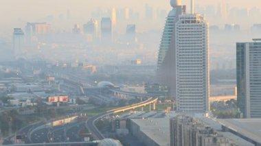 Dubai Sheikh Zayed Road skyscraper sunset metro UAE — Stock Video