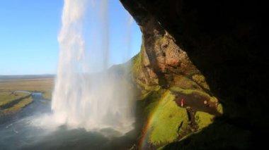 Iceland Seljalandsfoss Waterfall people rainbow — Stock Video