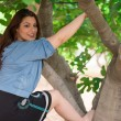Girl climbing on a fig tree — Stock Photo #75115257