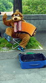 Street musician in bear suit on the street of Berne — Stock Photo