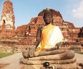 Buddha in yellow robe — Stock Photo