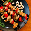Chicken kebabs with zucchini and paper on black plate — Stock Photo #59623433
