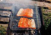 Salmon kebabs steak grilling outside — Stock Photo