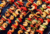 Shrimp kebabs on baking, diagonally — Stock Photo