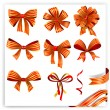 Set of red and gold gift bows with ribbons. — Stock Vector #62608737