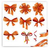 Set of red and gold gift bows with ribbons. — Stock Vector