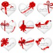 Festive heart-shaped  cards with red gift ribbons. — Stock Vector #63143643