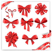 Set of red polka dot gift bows with ribbons. — Stock Vector