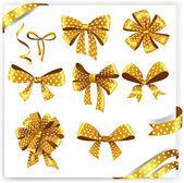 Golden polka dot gift bows — Stock Vector
