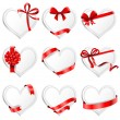 Heart-shaped cards with gift ribbons. — Stock Vector #63810565