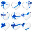 Set of beautiful heart-shaped cards with blue gift bows. — Stockvektor  #65055169