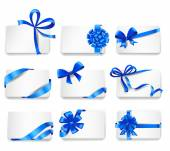 Set of beautiful cards with blue gift bows. — Vector de stock
