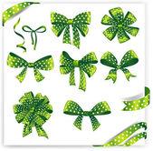 Set of green polka dot gift bows with ribbons. — Stock Vector