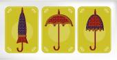 Three old, dotted umbrellas, yellow card — Stock Vector