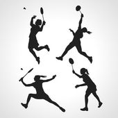Silhouettes of women professional badminton players. Vector set — Stok Vektör