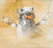 Christmas card: toy snowman on white sheep fur background — Stock Photo