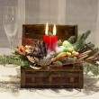 Christmas decoration: box with candles, Christmas tree and wine glasses — Stock Photo #62009717