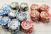 Stapels van de poker chips op de witte achtergrond — Stockfoto