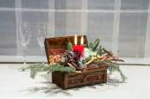 Christamas decoration for house: wooden box with candles, Christamas tree, flowers and two wine glasses — Stock Photo