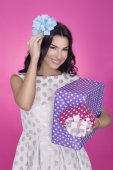 Beautiful women in pink background with present. Party. Love. Gift. — Stock Photo