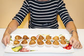 Woman with home made muffins — Stock Photo