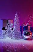 Christmas gifts and decorations on a purple background — Stock Photo