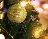Golden ball on the Christmas tree branch — Stock Photo