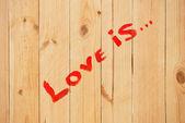 Love sign on wood texture — Stock Photo