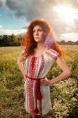 Beautiful red haired woman in Ukrainian national dress — Stock Photo