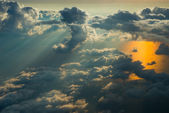 Above the clouds on sunset — Foto Stock