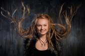Smiling blond woman with fluttering dreadlocks — Stock Photo