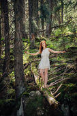 Woman walking in the mystery forest — Stock Photo