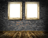 Two wooden frames on a old bricks wall. — Stok fotoğraf