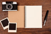 Blank notebook with pen, photo frames and camera — Stock Photo