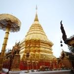 Golden pagoda with buddha statue , wat Phra That Doi Suthep, Thailand — Stock Photo #60412239