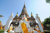 Group of buddha statue with pagoda, Wat Yai Chaimongkol, Thailand — Stock Photo