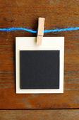 Blank photo frames on blue line — Stock Photo