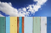 Blue sky with clouds and wood planks — Stock Photo