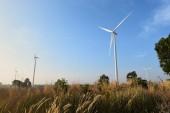 Wind turbine against cloudy blue sky background — Stock Photo