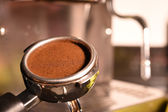 Freshly ground coffee beans in a metal filter — Stok fotoğraf