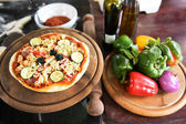 Cheese on a freshly prepared pizza — Stok fotoğraf