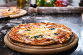 Pizza on wooden board. — Stock Photo