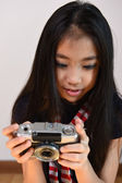 Little girl shooting with a vintage camera — Stock Photo