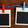 Blank photo frames on red and blue line — Stock Photo #64033343