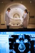 Veterinarian doctor working in MRI scanner room with moniter foreground — Stock Photo