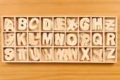 English alphabet set in wooden box — Stock Photo