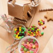 Decorating a gingerbread house — Stock Photo #60157081