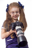 Little girl with a camera — Stock Photo