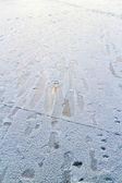 Footprints on the slippery ice — Stock Photo
